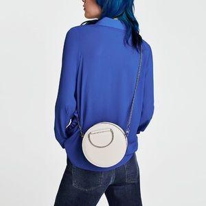 Zara Bags - Zara ecru oval mini crossbody bag